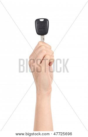 Vertical View Of A Woman Hand Holding Up A Car Key