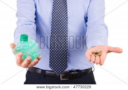 Businessman holding crushed bottle and coins.