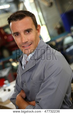 Portrait of coachbuilder standing in autoshop