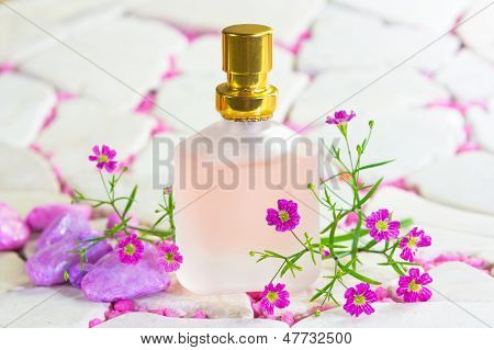 Pretty Frosted Bottle Of Perfume With Flowers