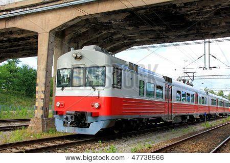 Commuter Train Under Bridge
