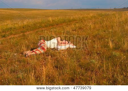 Woman With Ribbons Sleep In The  Meadow