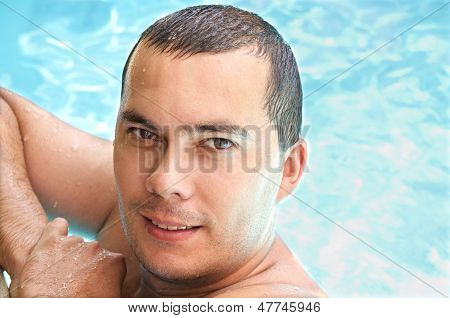 Portrait Of A Young Man In Swimming Pool