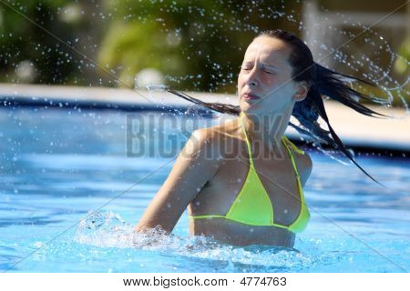 Woman Splashing In The Water