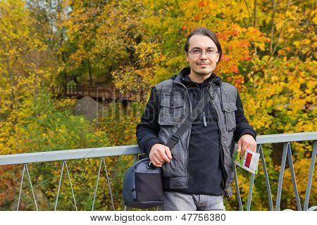 Man Tourist In Autumn Park