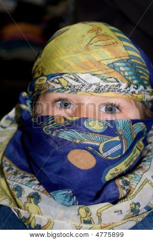 Curious European Child Dressed In The Arabian Headscarf