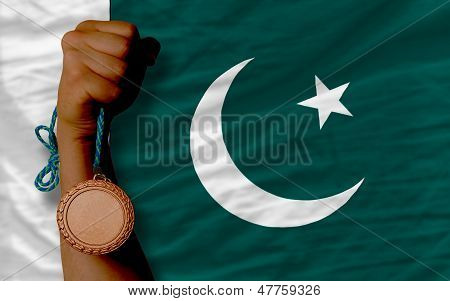 Bronze Medal For Sport And  National Flag Of Pakistan