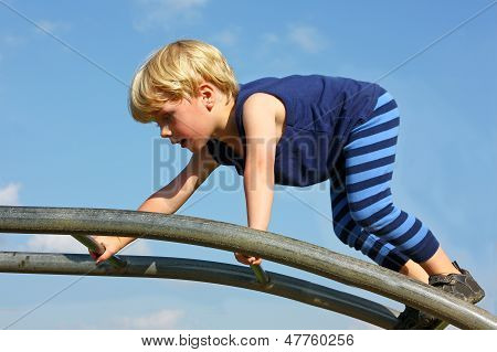 Child Climbing Playground Ladder