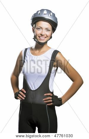 Nice Closeup Portrait Of Female Bike Athlete Smiling And Standing Against White Background
