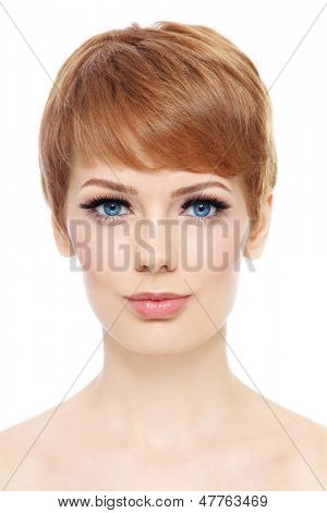Portrait of young beautiful woman with stylish short haircut over white background