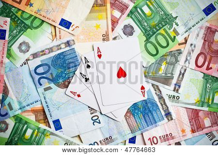 the poker cards and euro banknotes