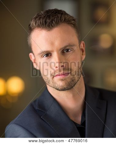 Portrait of smart young businessman at coffeeshop