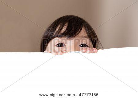Big Beautiful Eyes Peeking Over White Copy Space