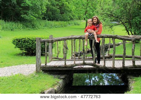 Adorable little boy with mom on bridge