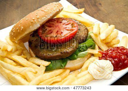 hamburger bun with fries