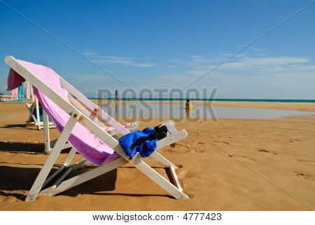 Sun Chair On Beach In Paradise
