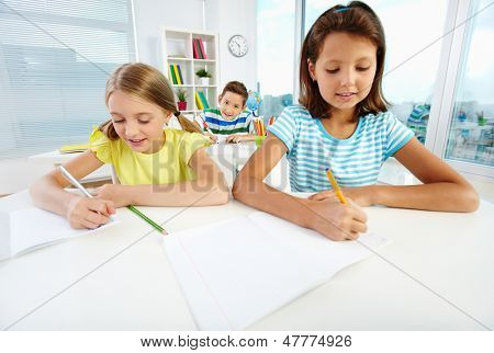 Diligent pupils being busy doing their schoolwork