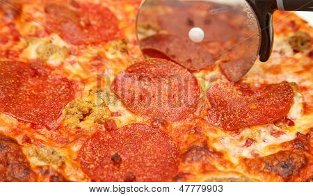 Slicing A Hot Pepperoni Pizza