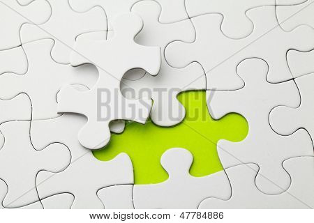 Puzzle with missing piece in green color