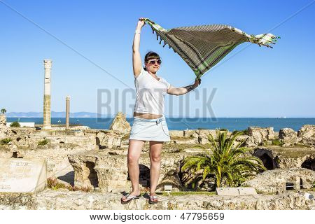 Girl With A Scarf In The Wind Against A Backdrop Of Therm Antonia In Tunisia Carthage.