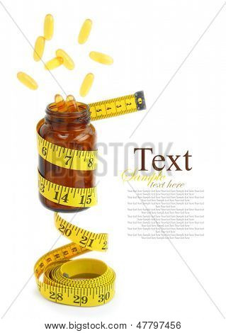Vitamin Omega 3 fish oil capsules come out from a medicine bottle with a measuring tape