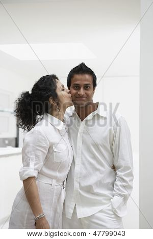 Woman kissing man's cheek