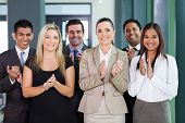 stock photo of applause  - smiling business group applauding for good news - JPG