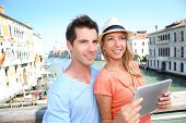 foto of academia  - Couple using tablet on the Academia Bridge in Venice - JPG