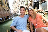 stock photo of gondola  - Couple in Venice having a Gondola ride on the canal - JPG