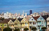 stock photo of victorian houses  - The famous painted ladies house in San Francisco California with skylin - JPG