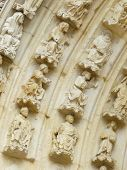 picture of poitiers  - Carved stone lintel on a church door in France - JPG