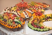 stock photo of banquet  - Fruits on banquet table - JPG