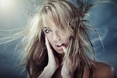 stock photo of beautiful lady  - Lady outdoors with long hairs blown by the cooling wind - JPG