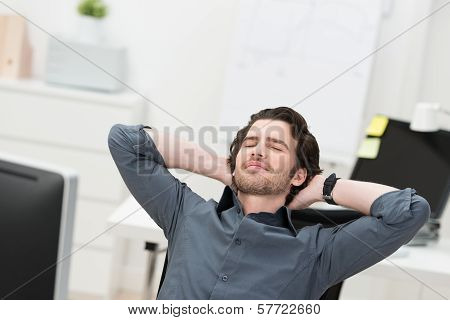 Businessman Taking A Break At His Desk