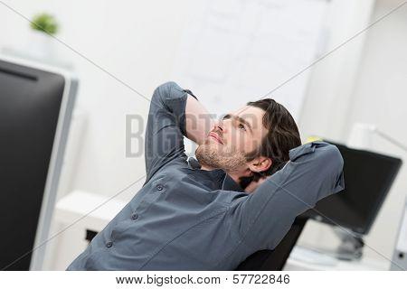 Businessman Sitting Daydreaming