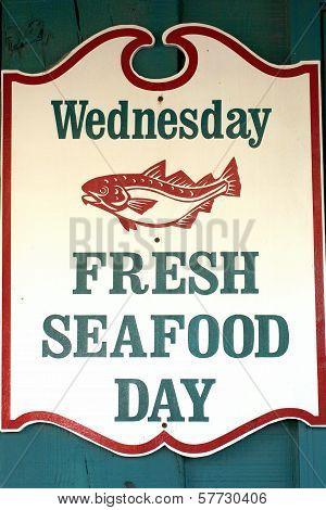 Fresh seafood sign.