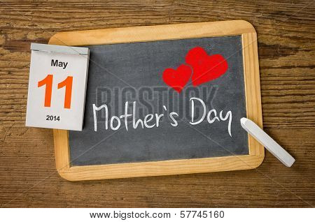 Mothers Day 2014 May 11 written on a blackboard