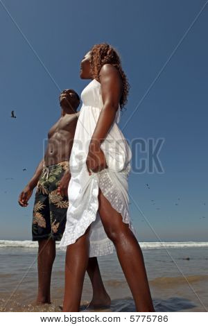 Happy African American Couple Walking Along The Beach
