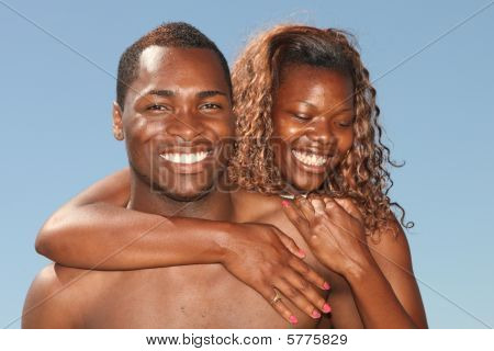Couple Of African American Descent Smiling Outdoors