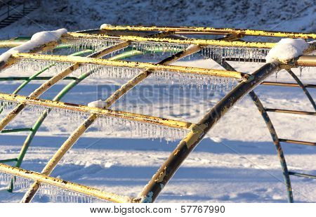 Icicles on playground equipment after an ice storm.