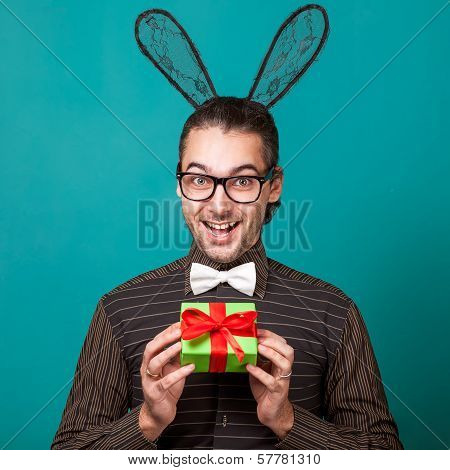 Fashion Guy In Bunny Ears Of Holding Gift. Valentine's Day