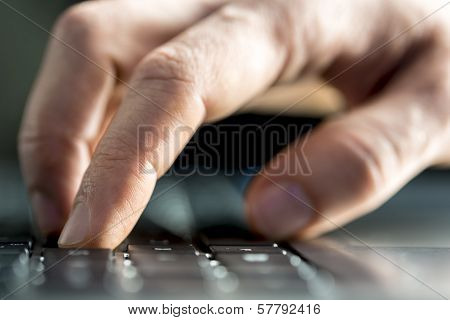 Man Typing On A Laptop Computer