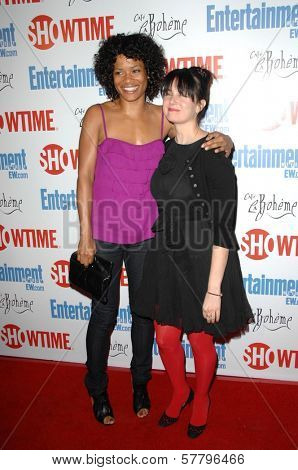 Rose Rollins and Mia Kirshner  at the farewell party for final season of 'The L Word'. Cafe La Boheme, West Hollywood, CA. 03-03-09