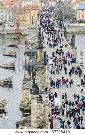 Tourists walk along the Bridge