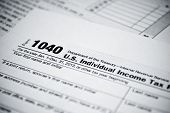 stock photo of american money  - Blank income tax forms. American 1040 Individual Income Tax return form.