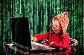 picture of encoding  - Little child typing on the keyboard - JPG