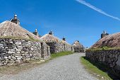 image of outer core  - Gearrannan restored black houses Isle of Lewis Outer Hebrides Scotland .