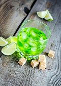 foto of absinthe  - Glass of absinthe with lime and sugar cubes - JPG