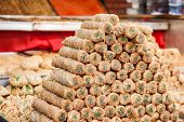 stock photo of baklava  - Oriental sweets on sale in the Carmel Market in Tel - JPG