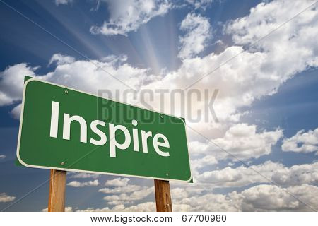 Inspire Green Road Sign with Dramatic Clouds and Sky.